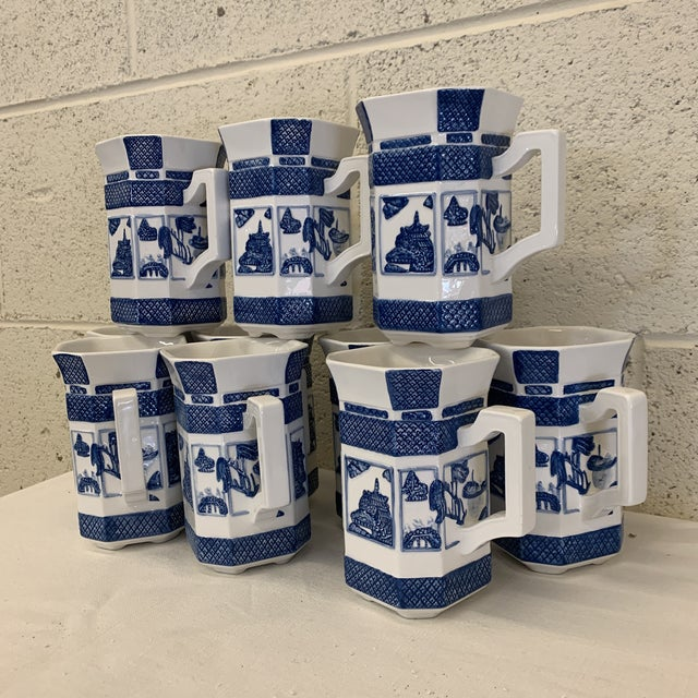 Exquisite set of 10 blue and white ceramic coffee mugs with Pagoda motif. What I really love about these is that they are...