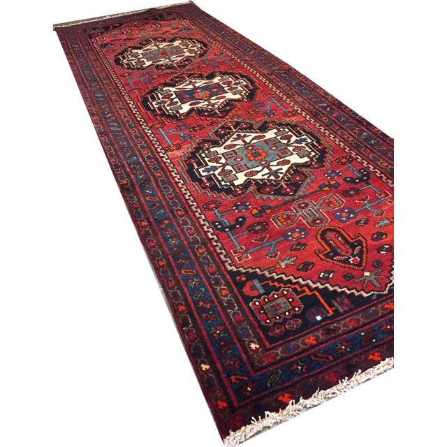 From Zanjan in Persia near to Azerbaijan this hand knotted runner has wonderful colors and designs that will help it work...