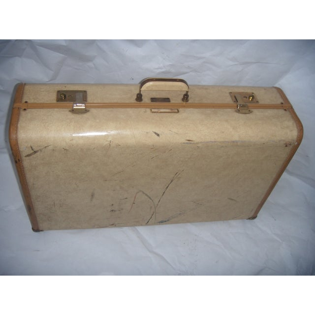 A nice old Penney's Towncraft vinyl suitcase with a key. Nice inside fabric. In decent shape, I did not try to remove...