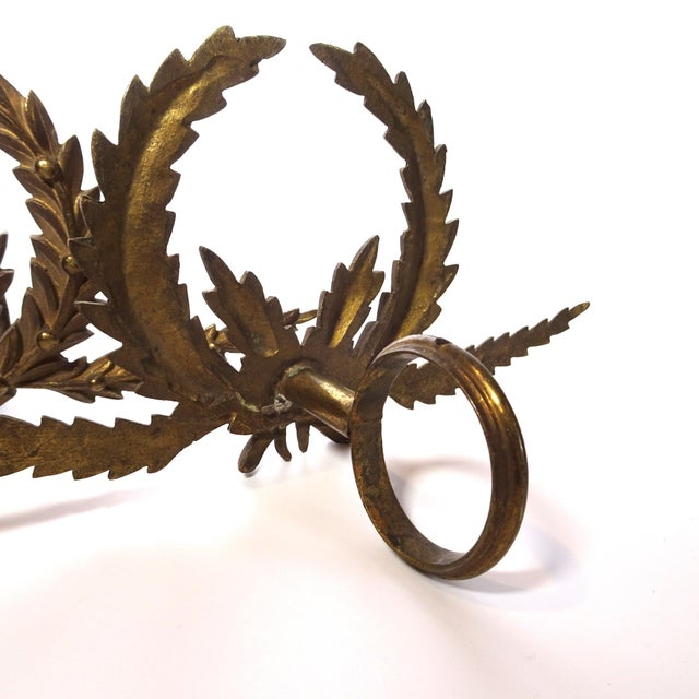 A great pair of Antique french brass drapery rod holders with garland design.