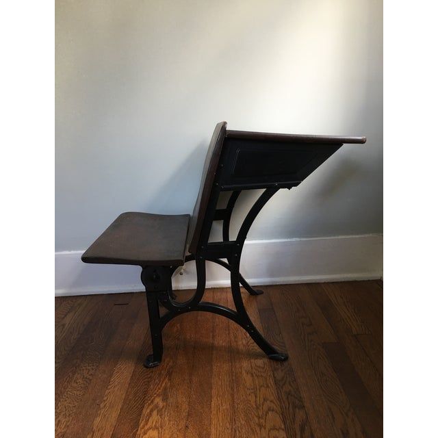 A piece of history! This 1916 Heyward Wakefield school desk includes a folding bench seat, quill and ink holder, and shelf...