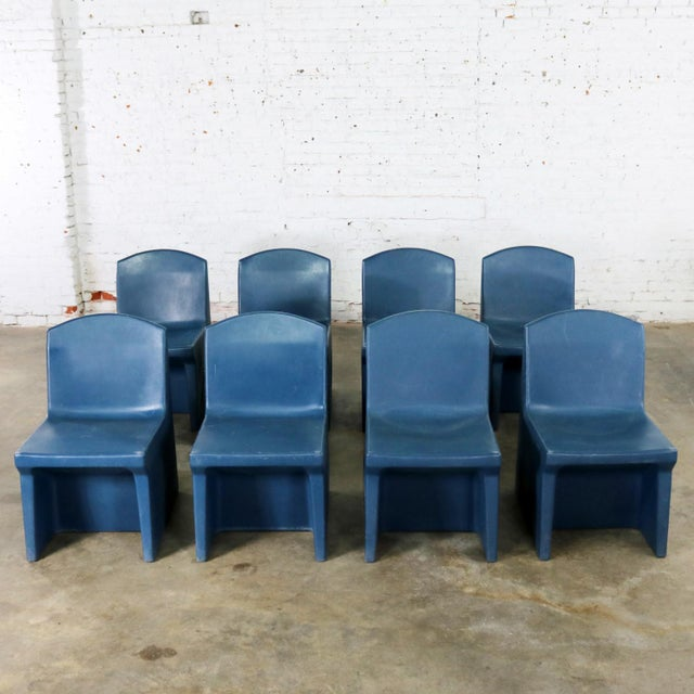 Fun and useful set of eight blue molded polyethylene plastic side or slipper chairs by Norix from the Toughcare Series. In...