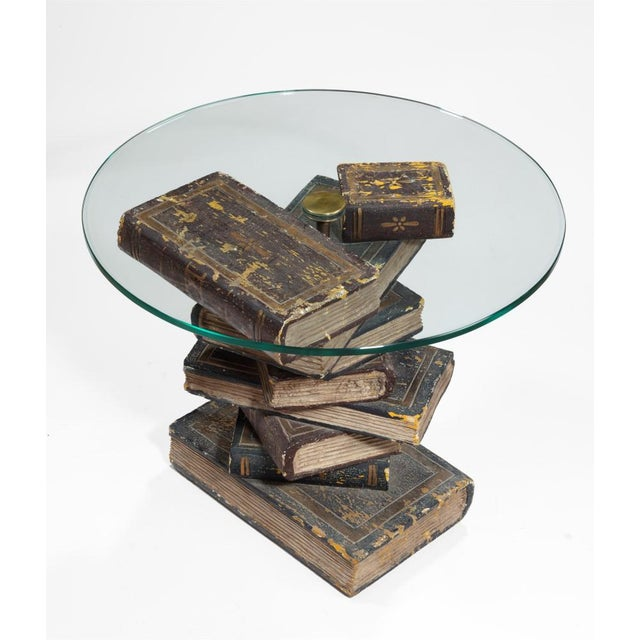 A rare to piece to find, this table has a glasstop on top of a pile of 9 carved books.