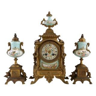 Three-Piece Gilt Porcelain Clock Set For Sale