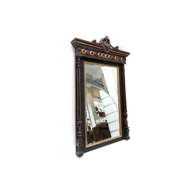 A good quality Regency style giltwood and black lacquered overmantel mirror. 19th century.
