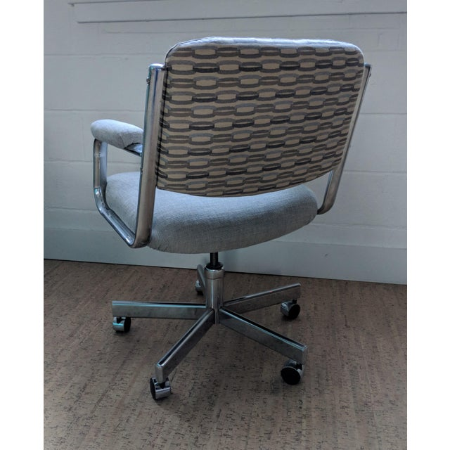 A splendid Chromcraft office chair that has been restored to 21st century glory. We have used a gray and blue patterned...