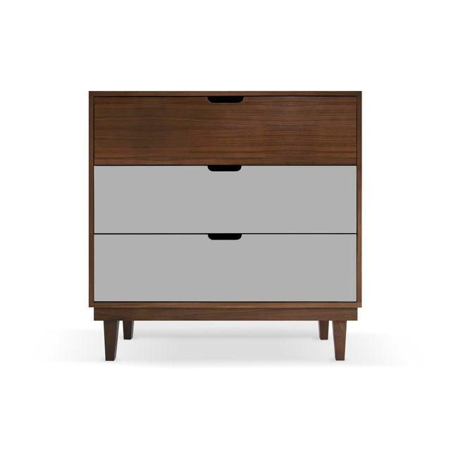 Kabano Modern Kids Walnut Wood 3-Drawer Dresser. A simple elegant design, a modern take on a '50s inspired shape. Our...