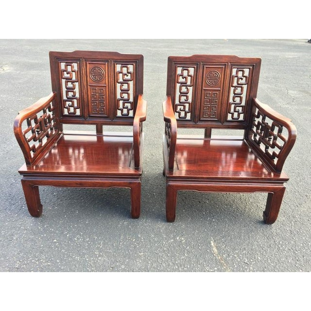 Antique carved Chinese Chippendale rosewood. Gorgeous intricate carving.  Comes with two original loose cushions - Antique Carved Chinese Chippendale Rosewood Chairs - A Pair Chairish