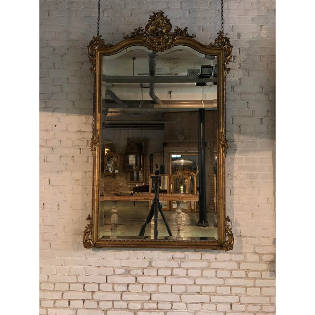 19th century mirror, gold leaf gilded in the style of Louis XV, Provenance France This 19th Century Mirror is adorned with...