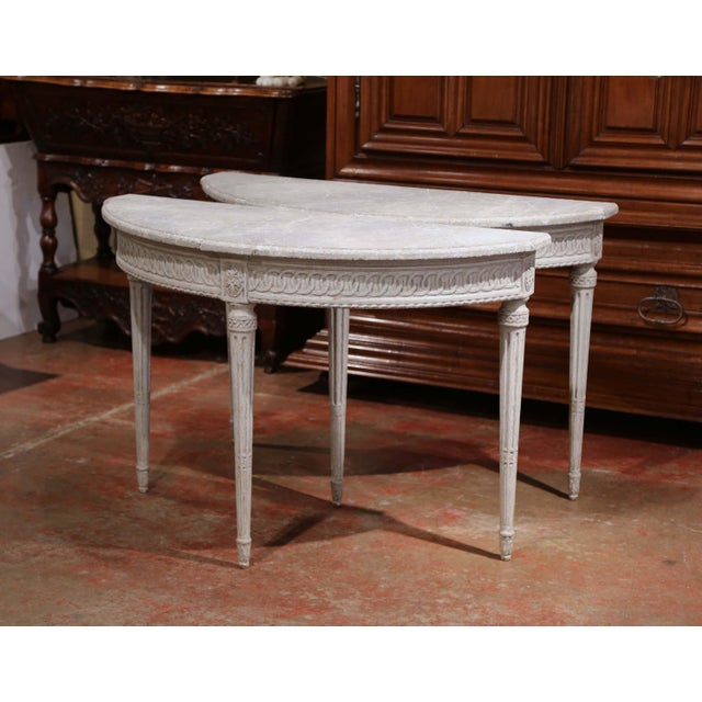 Decorate an entryway with this sophisticated pair of antique consoles shaped as half moon. Crafted in northern France...