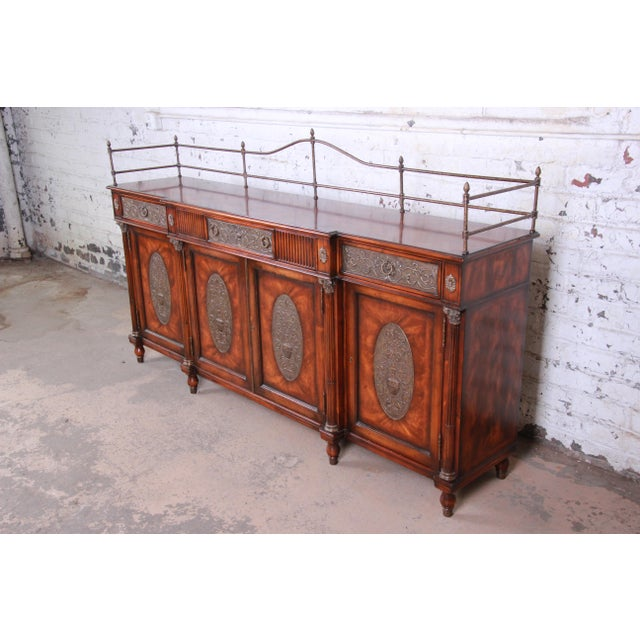 An exceptional and monumental Regency style sideboard buffet or bar cabinet by Theodore Alexander. The sideboard features...