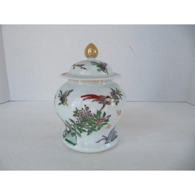 A beautiful vintage Chinoiserie ginger jar with all of the colors of Spring, green, pink, yellow. Butterflies, birds and...