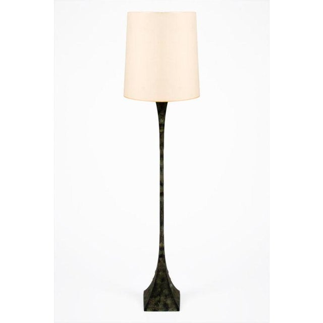 A fantastic pair of floor lamps in a slender mod double-splayed form and verdigris patina. By Stewart Ross James for...