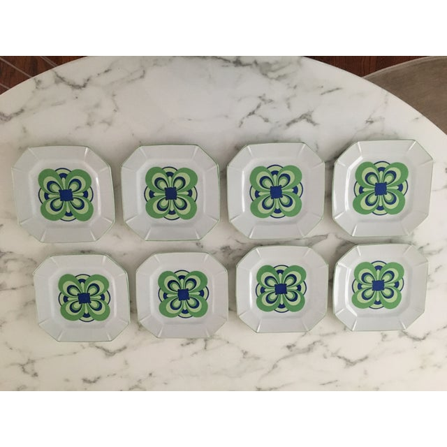 Gorgeous vintage plates with a blue and green design adorned on the white plates. There is no makers mark but I'm guessing...