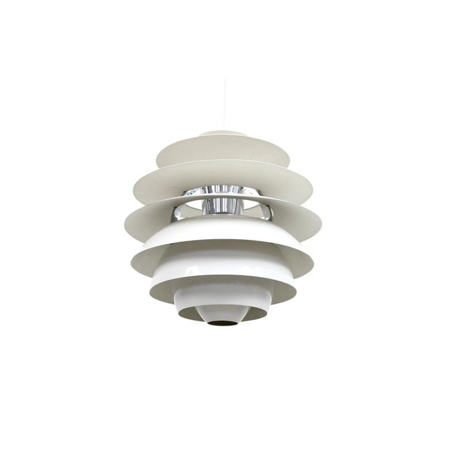 Snowball pendant designed in 1958 by Poul Henningsen for the Danish lighting company Louis Poulsen. Architectural louvered...