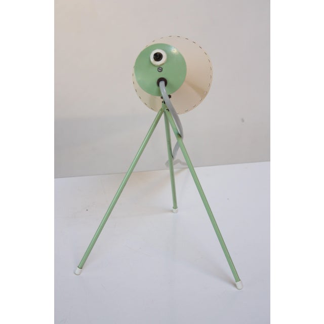 Czech table lamp designed in 1958 by Josef Hurka for Napako. Rare and early light mint green enameled tripod base with...
