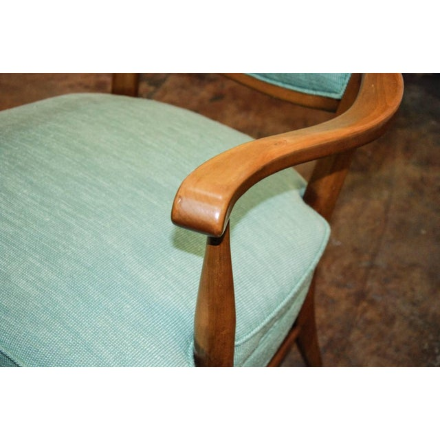 circa 1950 A tall and striking pair of blonde wood armchairs with tapered horn shaped backs often attributed to Edward...