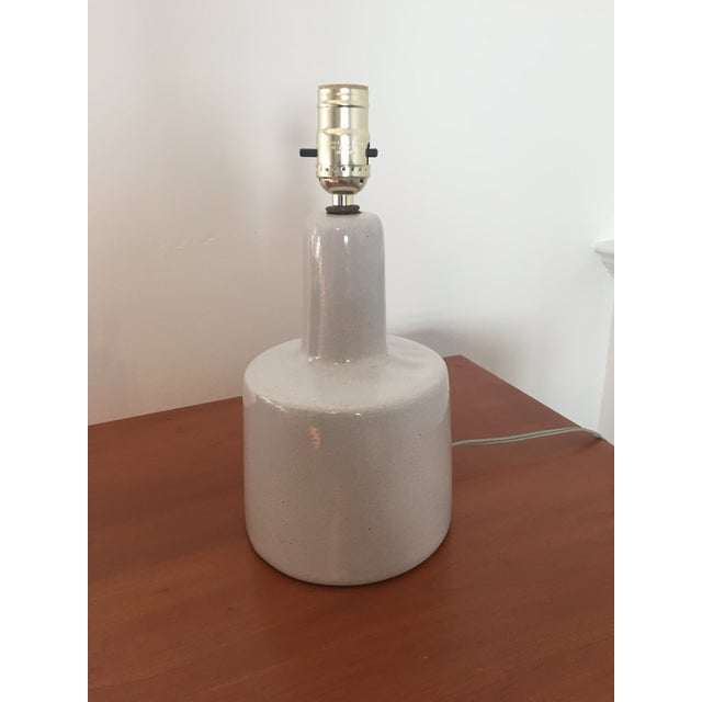 Brilliant 1960s glazed grey stoneware table lamp designed by Jane and Gordon Martz for Marshall Studios Inc. This lamp has...