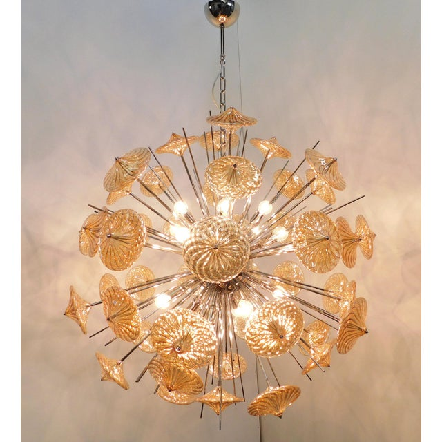 Italian modern Sputnik chandelier with amber Pyrex borosilicate glasses hand blown to produce a spiraled effect, mounted...