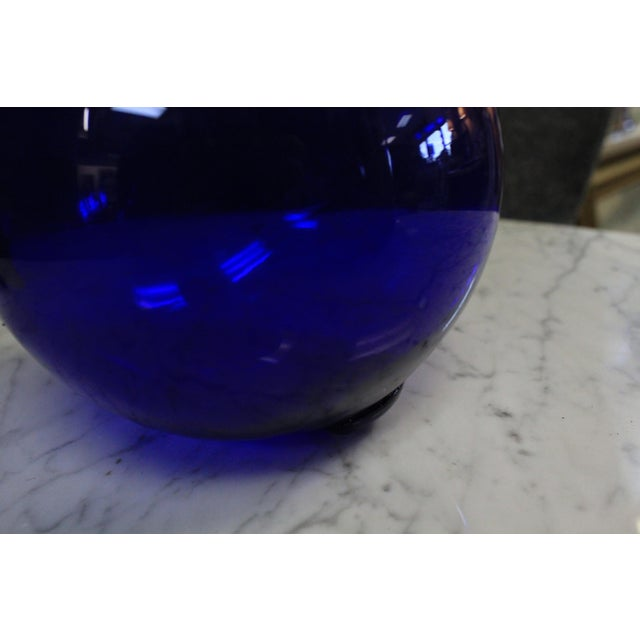 Beautiful transparent cobalt blue decorative ball hand made of blown glass.