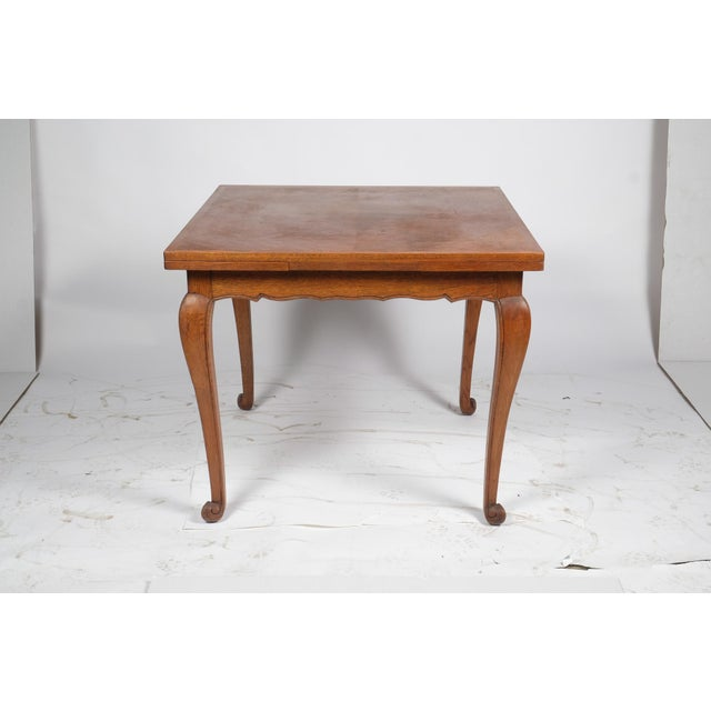 "Louis Philippe-Style square parquet table featuring a simple design along apron and cabriole legs, table extends to 59.25""..."