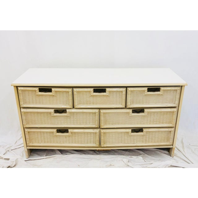 Vintage Palm Beach Chic Faux Bamboo Dresser complete with 7 drawers and original gold brass hardware. Nice size and shape...
