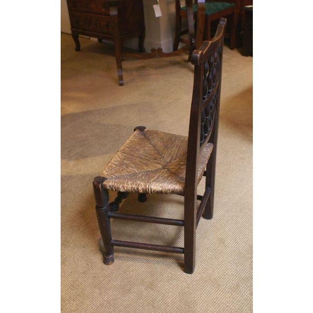 A decorative 18th Century English oak rush seated chair from about 1780. Great color and patina. The frame is solid...