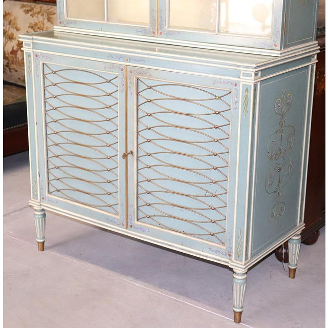Combining French reeded tapered legs and hand-painted details, this decidedly English piece is just delicious! Look at the...