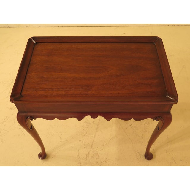 Henkel HarrisQueen Anne mahogany tea table. Features high quality construction, Queen Anne legs & pad feet, traditional...