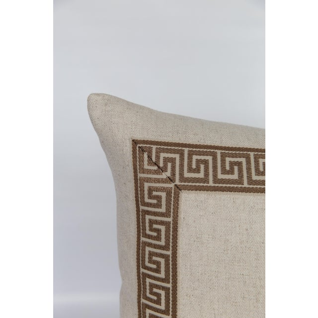 Pair of custom oatmeal-hued linen pillows with coordinating tan-and-coffee-colored Greek key tape borders. Solid linen...