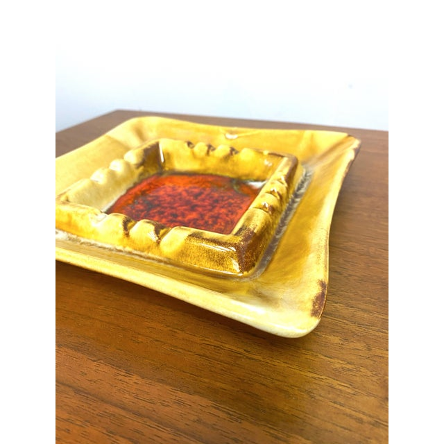 Flawless California pottery vintage Midcentury modern catchall or ashtray. Yellow with the middle having a lava glaze red....