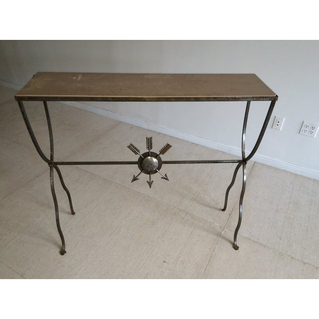 This Mid-Century steel and limestone console table is attributed to André Arbus, a celebrated French designer and...
