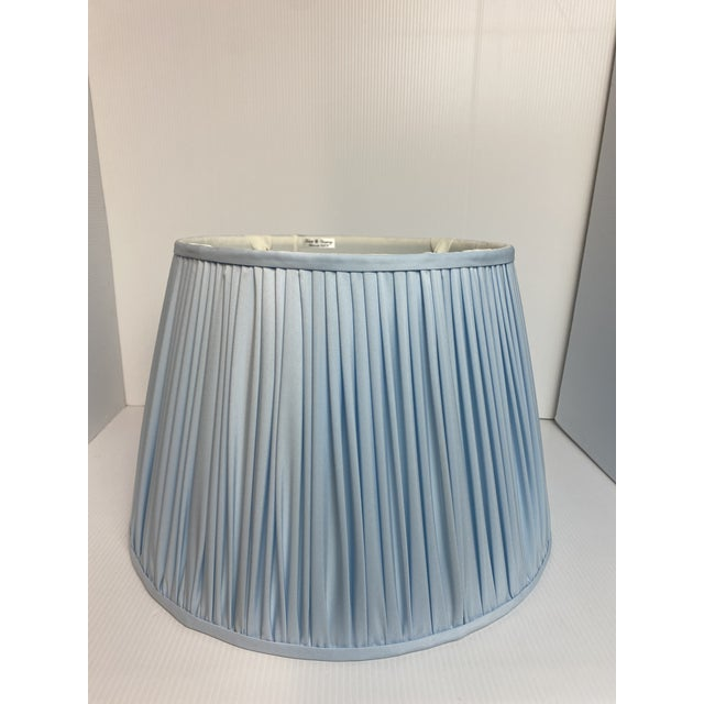 A Heath and Company original. This custom made soft lampshade comes shirred, in a powder blue color, with brass washer....