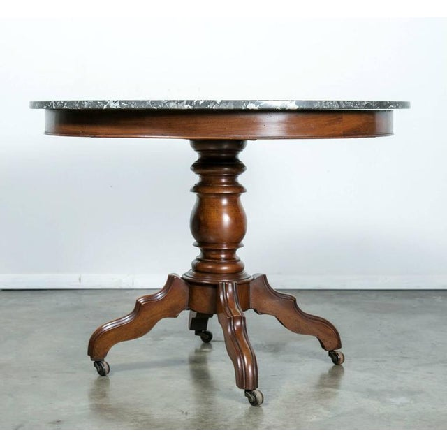 Elegant French Louis Philippe period gueridon or center table having a high polished gray Saint Anne marble top with white...