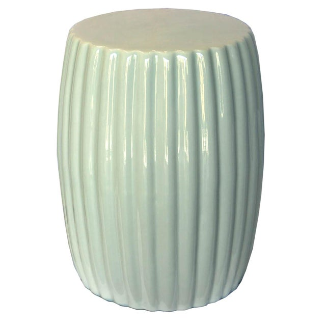 Light mint ceramic chrysanthemum design stools can also be used as a side table next to an arm chair in a modern house.