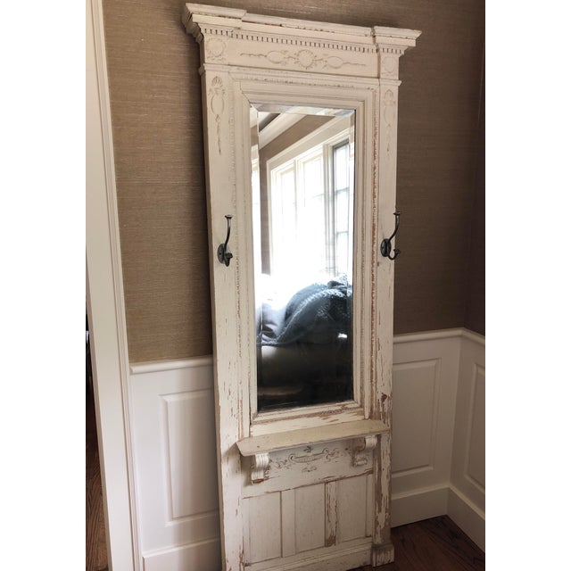 Antique wood floor mirror with hooks. Dress up your entryway with this floor mirror filled with character. Distress off...