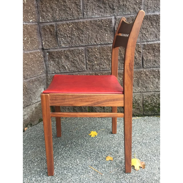 Gorgeous set of eight matching Danish teak dining chairs. Original deep red vinyl seats. Very comfortable and study.