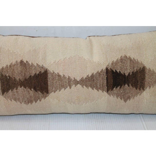 This is a somber Navajo weaving pattern in light colors and simple pattern. The condition is very good with a light brown...