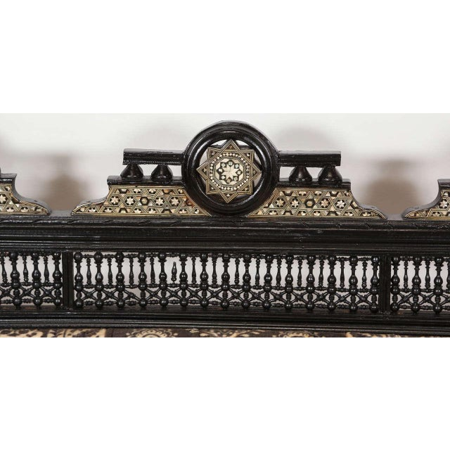 Middle Eastern Syrian black settee with spindle and ball design with triple Moorish arches inlaid with mother of pearls...
