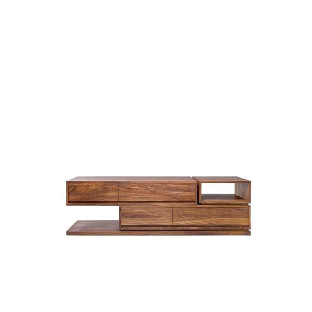 The bodega console was inspired by the simple lines and shapes os storage buildings or warehouses known in Spain as...