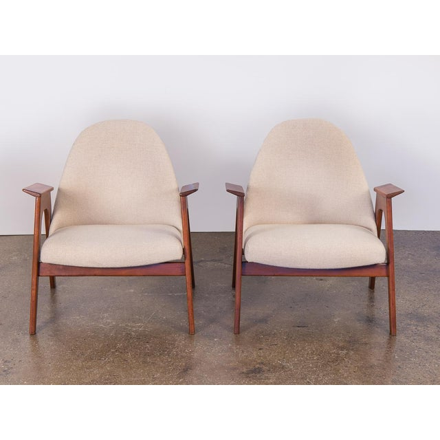 Spectacular pair of attractive American Walnut Armchairs. Architectural, unusual design form. In excellent condition. No...