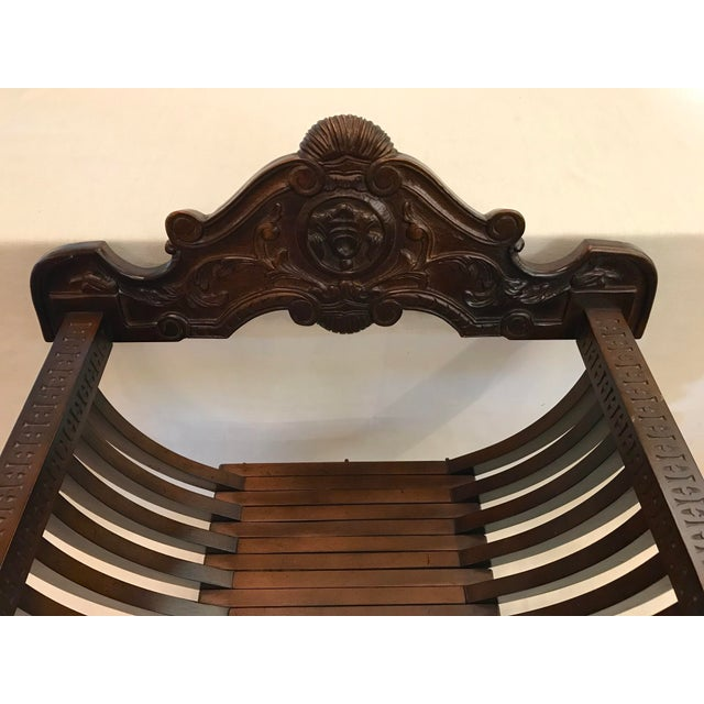 Vintage Italian wooden X-form Savonarola chair with hand carved details - scrolls on the back and and intricate carvings...