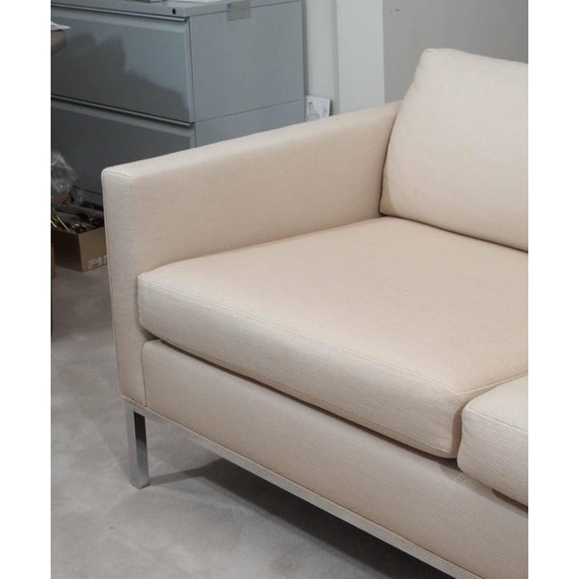 Handsome two-seat sofa in the style of Knoll; full-surround chrome-plated steel base; loose foam seat and back cushions;...