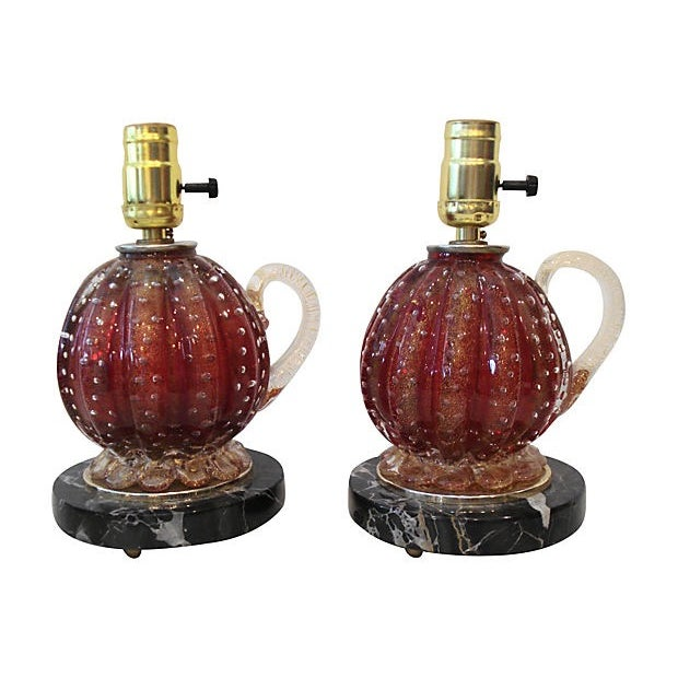 Rare pair of Murano art glass table lamps by Barovier & Toso. The lamps are raspberry-colored with gold aventurine and a...