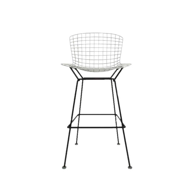 Nice original vintage Harry Bertoia bar stools designed in the 1950s. Exquisite stools with the trademark grid seat and...