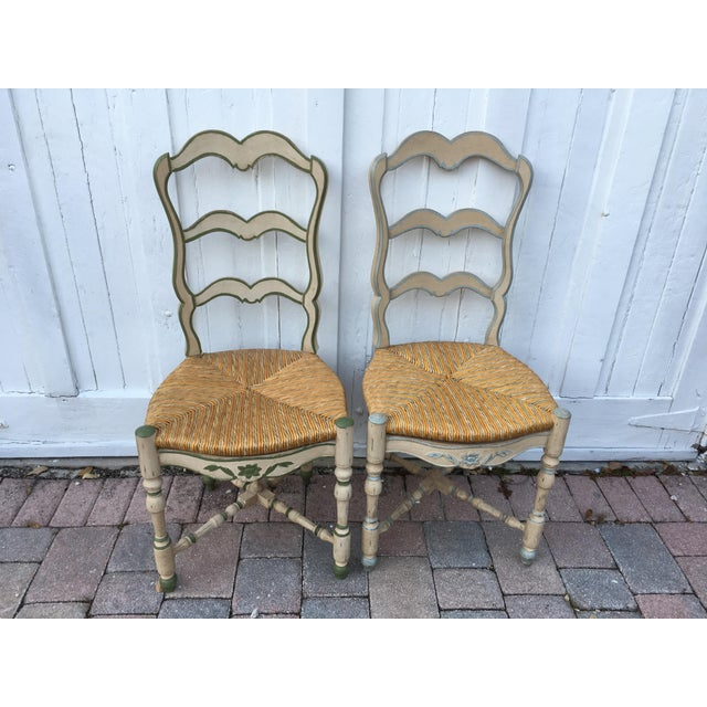 """France flea market find pair of ladder back style, hand painted wood and straw chairs. Seat is 18"""" height."""