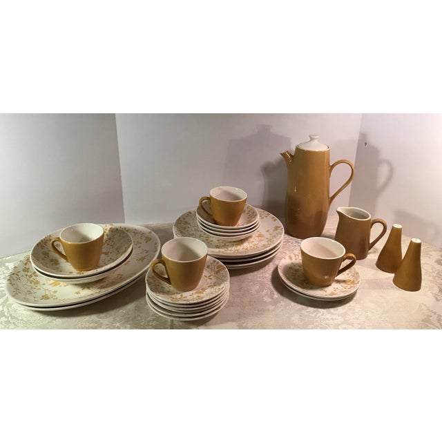 Nice set of mustard colored floral on cream Ironstone dishes. Includes: Coffee pot with lid Creamer Salt and pepper...
