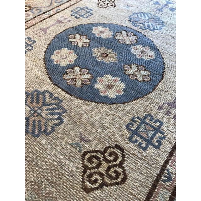 "Vintage Khotan Rug Origin: East Turkestan US Size: 4 ' 1 "" x 7 ' 3 "" Circa: Mid 20th Century Metric Size: 1.24 x 2.21 meters"