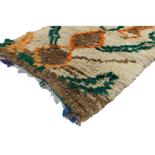 Vintage Berber Boucherouite Moroccan Azilal Rug with Expressionist Tribal Style. This vintage Moroccan Azilal rug features...