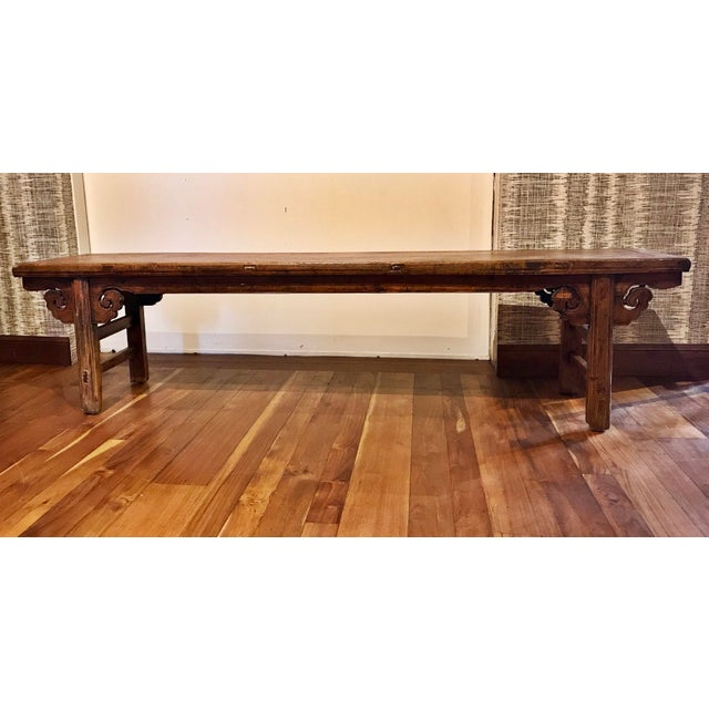 This Chinese antique bench is made with solid carved wood. Approximately 100-150 years old.